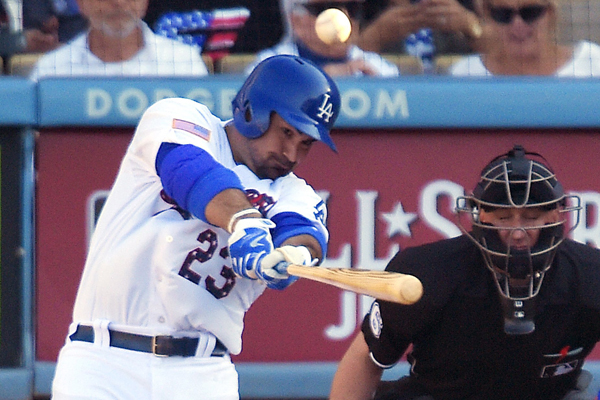 Dodgers first baseman Adrian Gonzalez hits a solo home run during the fifth inning of a 4-3 win over the New York Mets.