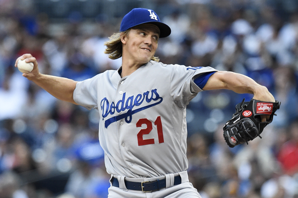Dodgers starter Zack Greinke delivers a pitch during the first inning of a loss to the San Diego Padres.