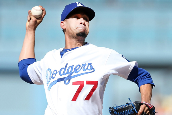 Dodgers starter Carlos Frias delivers a pitch during a 6-2 loss to the San Francisco Giants at Dodger Stadium.