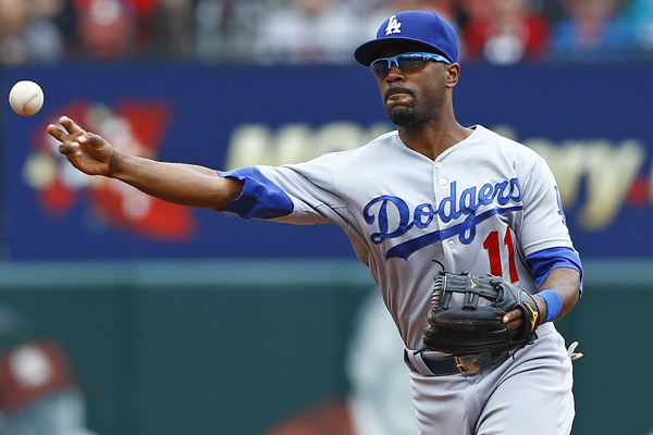 Dodgers shortstop Jimmy Rollins makes a throw to first base during the first inning of a loss to the St. Louis Cardinals.