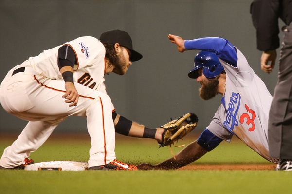 San Francisco Giants shortstop Brandon Crawford, left, tags out Dodgers baserunner Scott Van Slyke during the eighth inning of the Giants' win.