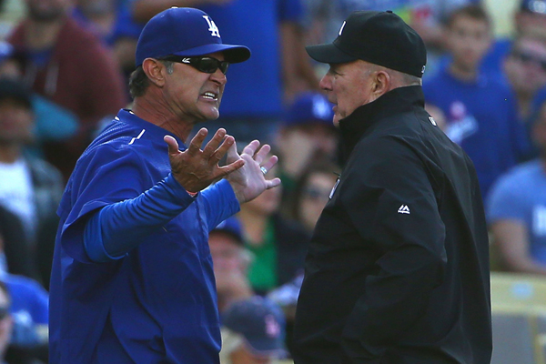 Dodgers Manager Don Mattingly argues a call with third base umpire Bob Davidson during the fourth inning of a loss to the Miami Marlins.