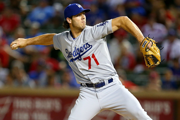 Dodgers reliever Josh Ravin delivers a pitch during the ninth inning of a loss to the Texas Rangers.