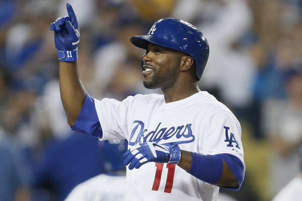 Dodgers shortstop Jimmy Rollins celebrates after hitting a three-run home run during the fourth inning of a win over the Arizona Diamondbacks.