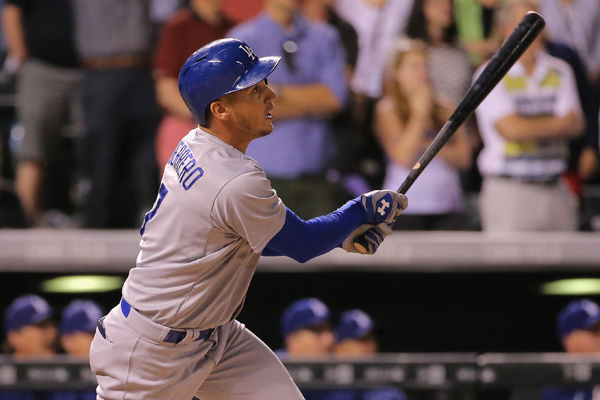 Dodgers left fielder Alex Guerrero hits a ninth-inning grand slam during a win over the Colorado Rockies in the second game of a doubleheader.