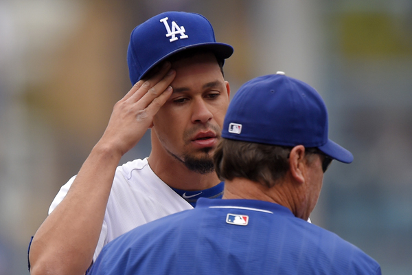 Dodgers pitcher Carlos Frias speaks with pitching coach Rick Honeycutt during the first inning of an 11-3 loss to the San Diego Padres.
