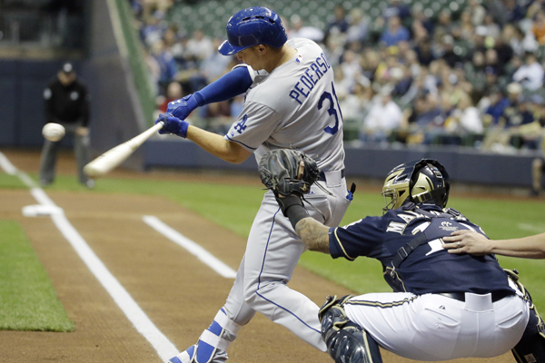 Dodgers center fielder Joc Pederson hits during the first inning of a loss to the Milwaukee Brewers.