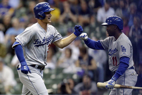 Dodgers center fielder Joc Pederson, left, celebrates with shortstop Jimmy Rollins after hitting a solo home run against the Milwaukee Brewers.