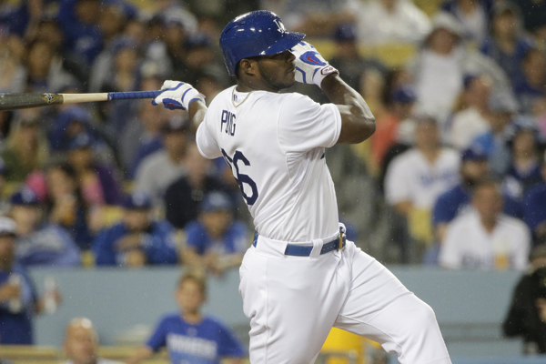 Dodgers right fielder Yasiel Puig hits a double during the seventh inning of a win over the Arizona Diamondbacks.