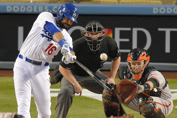 Dodgers right fielder Andre Ethier hits a two-run home run in front of San Francisco Giants catcher Buster Posey during the first inning of a 7-3 victory.