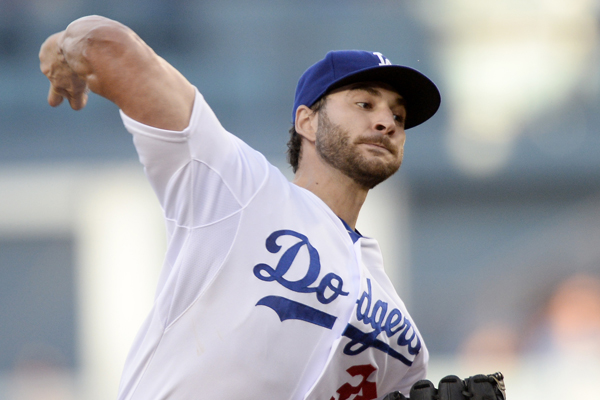 Dodgers starter Brandon Beachy delivers a pitch during the first inning of a 7-1 loss to the Milwaukee Brewers.
