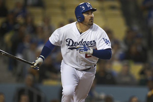 Dodgers first baseman Adrian Gonzalez singles during the seventh inning of a win over the Mariners.