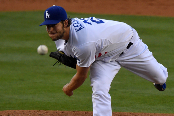 Dodgers starter Clayton Kershaw delivers a pitch during the first inning of the loss to the Texas Rangers.