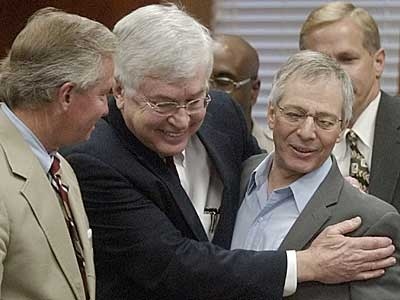 Lawyers Dick DeGuerin, left, and Mike Ramsey, center, congratulate Robert Durst after hearing that jurors in found him not guilty of murdering his neighbor Morris Black.