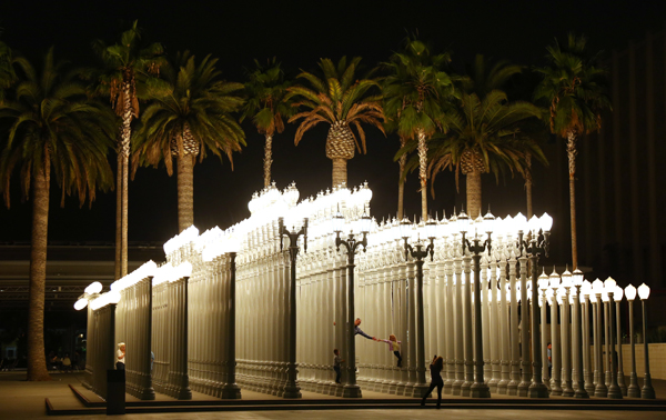 "LACMA visitors explore the <a href=""http://collections.lacma.org/node/214966"" target=""_blank"">""Urban Light"" sculpture by Chris Burden</a> on Oct. 20, 2012."