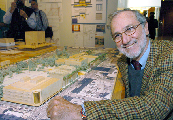 Architect Renzo Piano poses with a scale model of the redesigned LACMA campus.