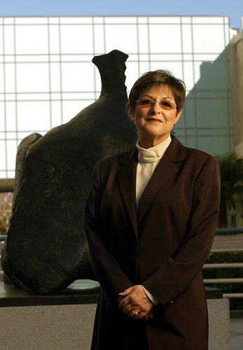 "Andrea Rich, president and director of LACMA, stands in front of Henry Moore's bronze statue <a href=""http://collections.lacma.org/node/234869"" target=""_blank"">""Three–Part Reclining Figure.""</a>"