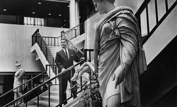 March 21, 1965. LACMA Director Richard F. Brown is photographed on a staircase in the atrium in the Ahmanson gallery before the museum's opening in 1965.