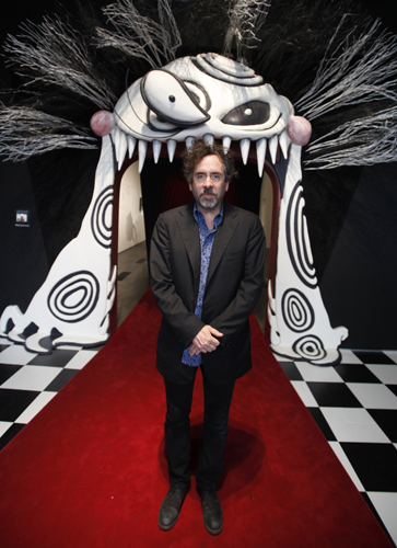 Tim Burton stands at the entrance to the LACMA exhibition devoted to his work as a filmmaker and illustrator.