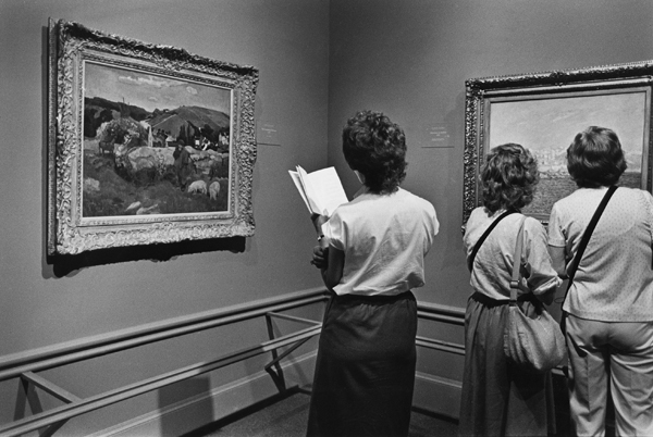 "LACMA visitors view French impressionists' paintings on display in the ""Day in the Country"" exhibit."