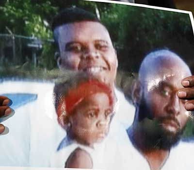 Michael Brown, top left, is pictured with his father, Michael Sr.