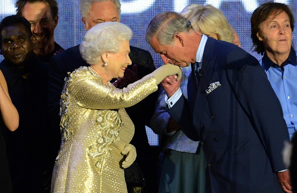 Prince Charles kisses his mother's hand at a Jubilee week concert at Buckingham Palace on June 4, 2012.