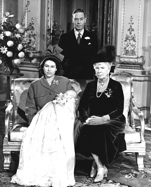 Princess Elizabeth holds her son, Prince Charles, in a portrait at Buckingham Palace following his christening Dec. 15, 1948. With Elizabeth are her grandmother, Queen Mary, and father, King George VI.