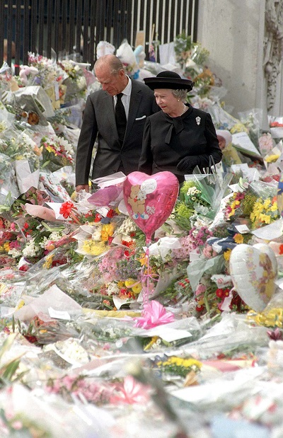 Queen Elizabeth II and her husband, Prince Philip, look at floral tributes left outside Buckingham Palace  on Sept. 5, 1997, following the death of Diana, Princess of Wales.