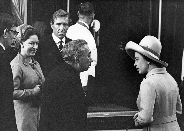 Queen Elizabeth II chats with Emperor Hirohito of Japan at Victoria Station at the start of his four-day state visit to London on Oct. 5, 1971. On the left are the queen's sister, Princess Margaret, and her husband, Antony Armstrong-Jones, 1st Earl of Snowdon.
