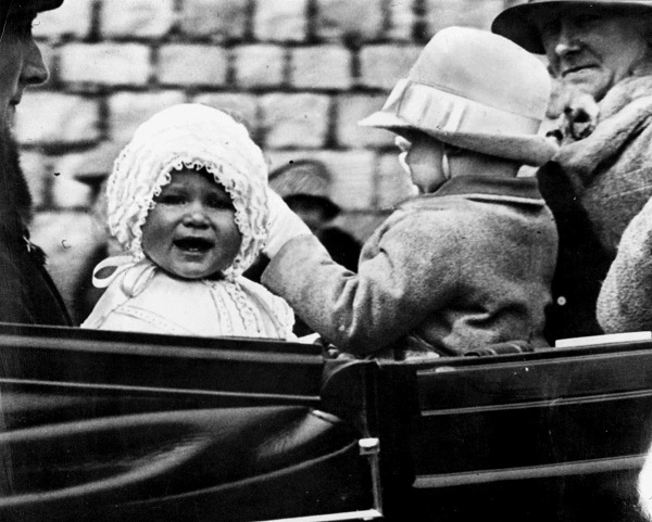 Princess Elizabeth, left, is taken for a ride on the grounds of Windsor Castle in 1927.