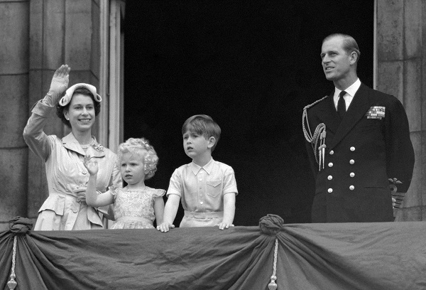 Prince Charles and Princess Anne with their parents, Queen Elizabeth II and the Duke of Edinburgh, on the balcony of Buckingham Palace on May 15, 1954.