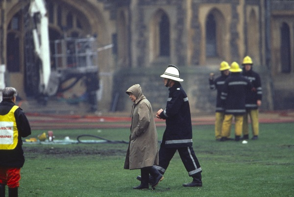 Queen Elizabeth II inspects the damage after a fire at Windsor Castle in November 1992.