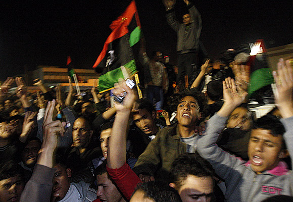 Streets erupt in cheers as news of the U.N. Security Council vote reach Libyan rebels in the eastern seaside city of Tobruk.
