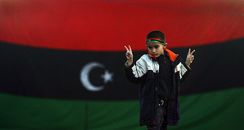 A boy celebrates the rebel victory in Ajdabiya.