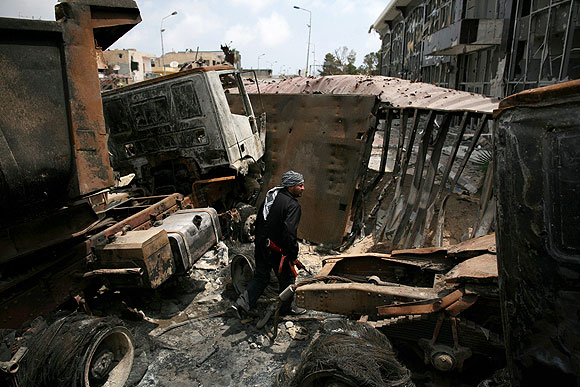 A rebel fighter surveys the damage after clashes with forces loyal to  Moammar Kadafi in Misurata.