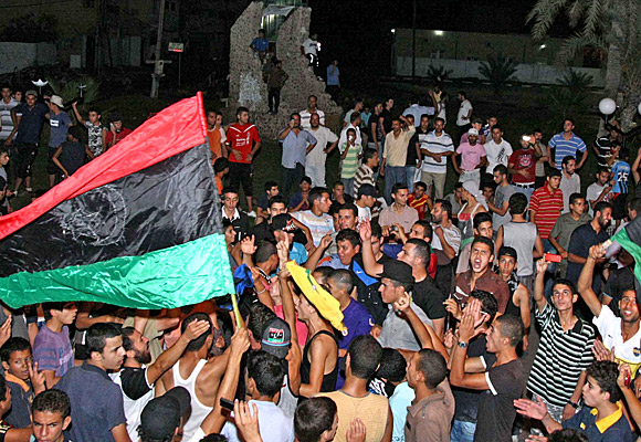 Thousands celebrate in Benghazi as rebel fighters push into Tripoli.