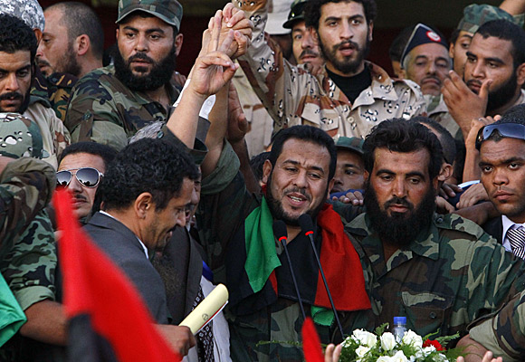 Abdel-Hakim Belhaj, center, a leader of the anti-Kadafi military forces.
