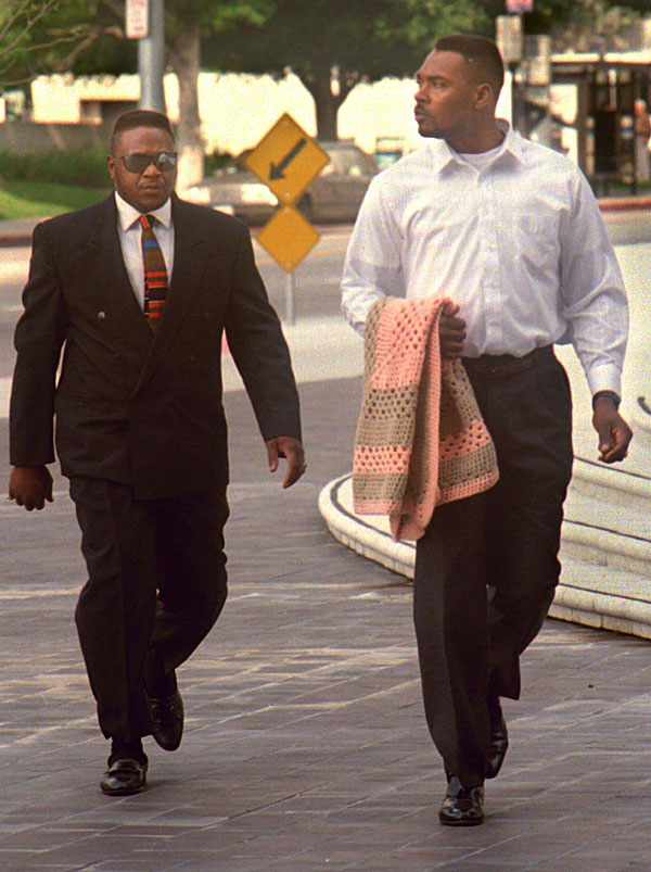 Rodney G. King, right, and unidentified man walking toward federal courthouse.