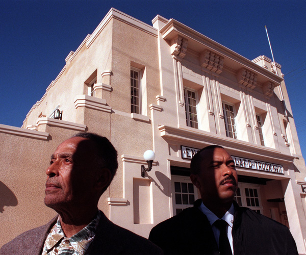 Arnett Hartsfield and Brent Burton stand in front of the African American Firefighter Museum, which was refurbished from the Fire Station 30 building.