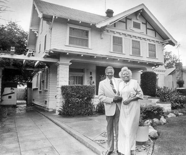 James and Carolyn Shifflett, in front of their home in Sugar Hill/West Adams. The Shiffletts were the first black couple to move to the area in 1947.