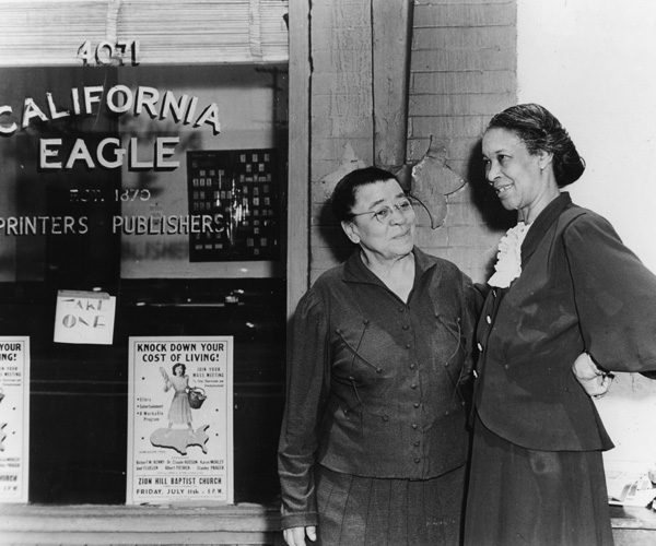 Charlotta Bass, left, with her niece in front of the California Eagle in 1944.
