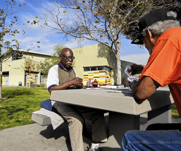 Mack Henry Conley, left, and Michael Jewell play pinochle at Fred Roberts Recreation Center on Honduras Street.