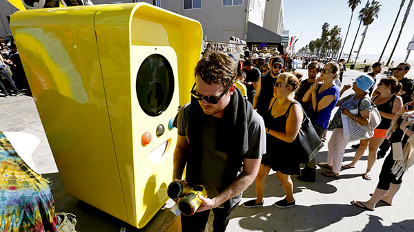 Snapchat Spectacles are dispensed from a bright yellow vending machine on the Venice Beach boardwalk.