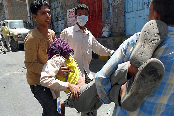 A Yemeni is carried away during clashes in the city of Taiz.