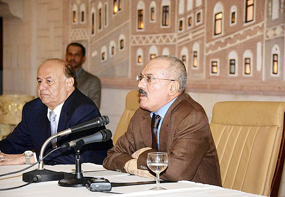 Yemeni President Ali Abdullah Saleh, right, delivers a speech on state TV in which he said he would step down soon. Vice President Abdu Rabu Mansour Hadi sits to Saleh's right..