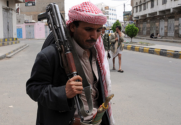 Tribesmen loyal to anti-government protesters demanding an end to the rule of Yemeni President Ali Abdullah Saleh patrol a street in Sana, the capital.