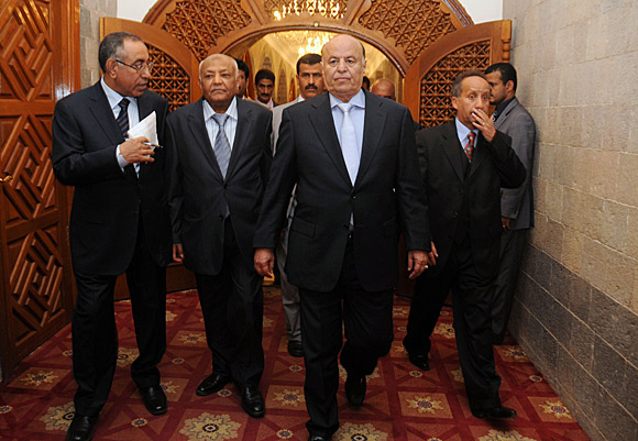 Yemeni Prime Minister Mohammed Basindwa, left, and Vice President Abdu Rabu Mansour Hadi arrive at the presidential palace in Sana.