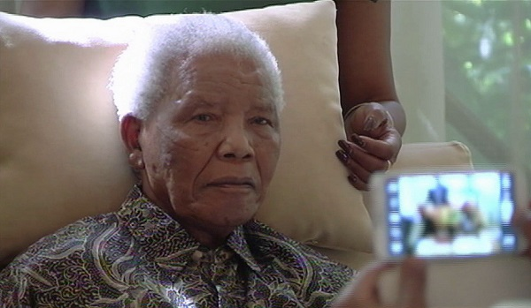 Mandela pictured more than three weeks after his April release from hospital.