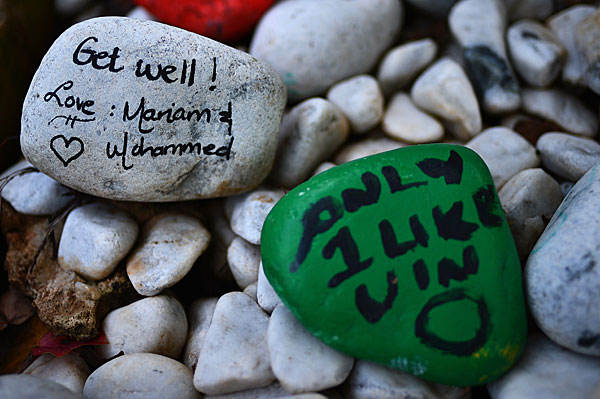 Stones painted with get-well messages are left outside Mandela's residence in the Houghton area of Johannesburg.
