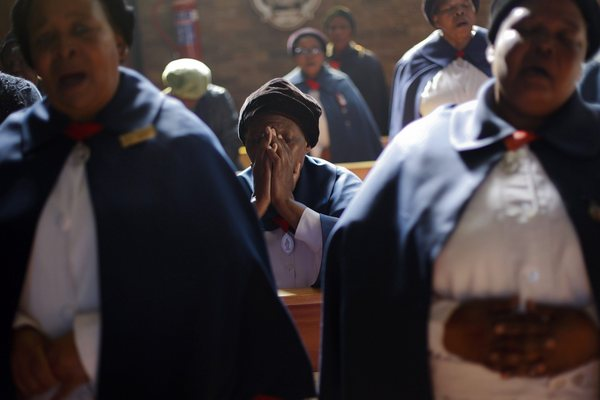 Congregants sing as they pray for Mandela during Sunday service at Regina Mundi church in Soweto township.